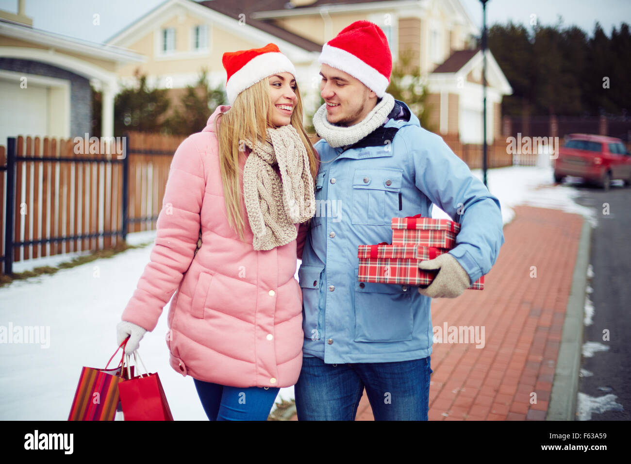 Happy couple doing Christmas shopping together - Stock Image