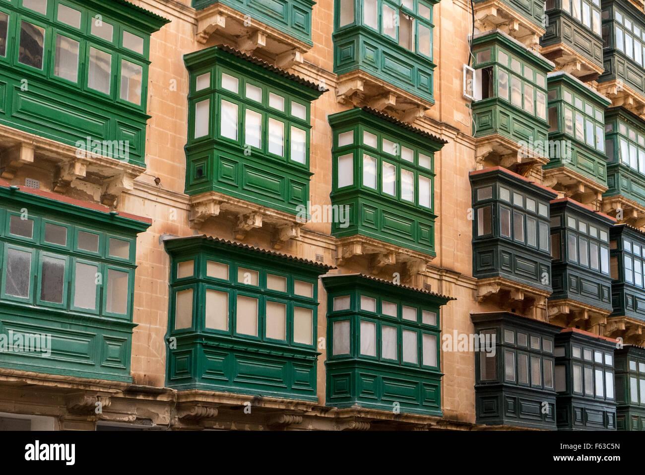 Green balconies and general cityscape in Valletta, Malta. - Stock Image