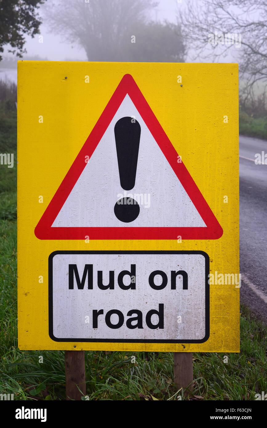 mud on road ahead warning sign yorkshire united kingdom - Stock Image