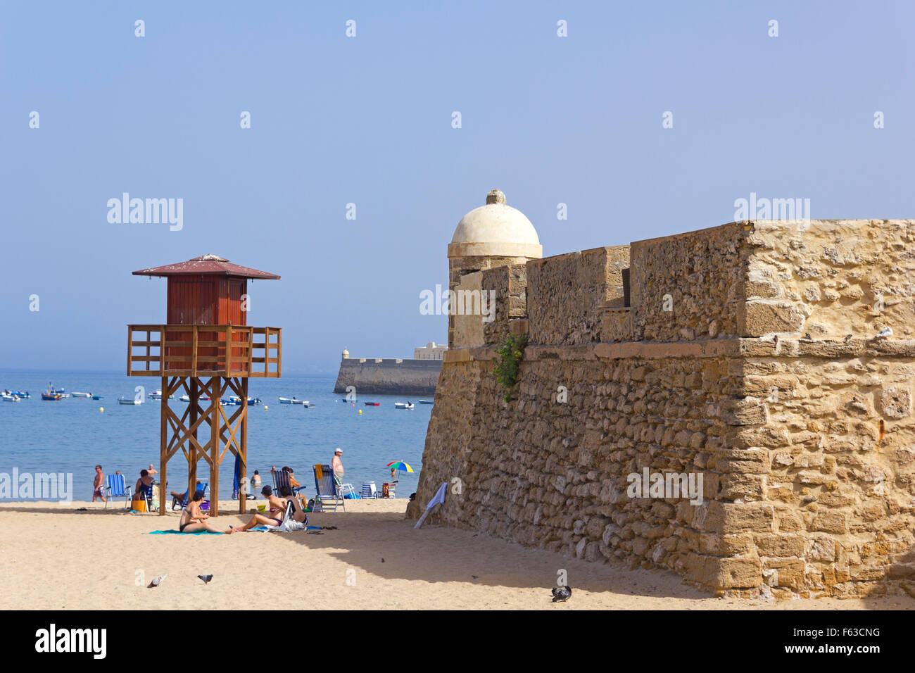 Caleta beach, in the middle of the old city, in Cadiz, Spain. - Stock Image