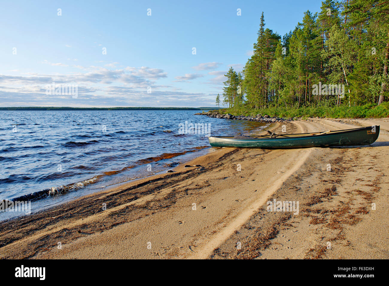 Canoe on a beach at Lentua lake, Kuhmo, Finland. - Stock Image