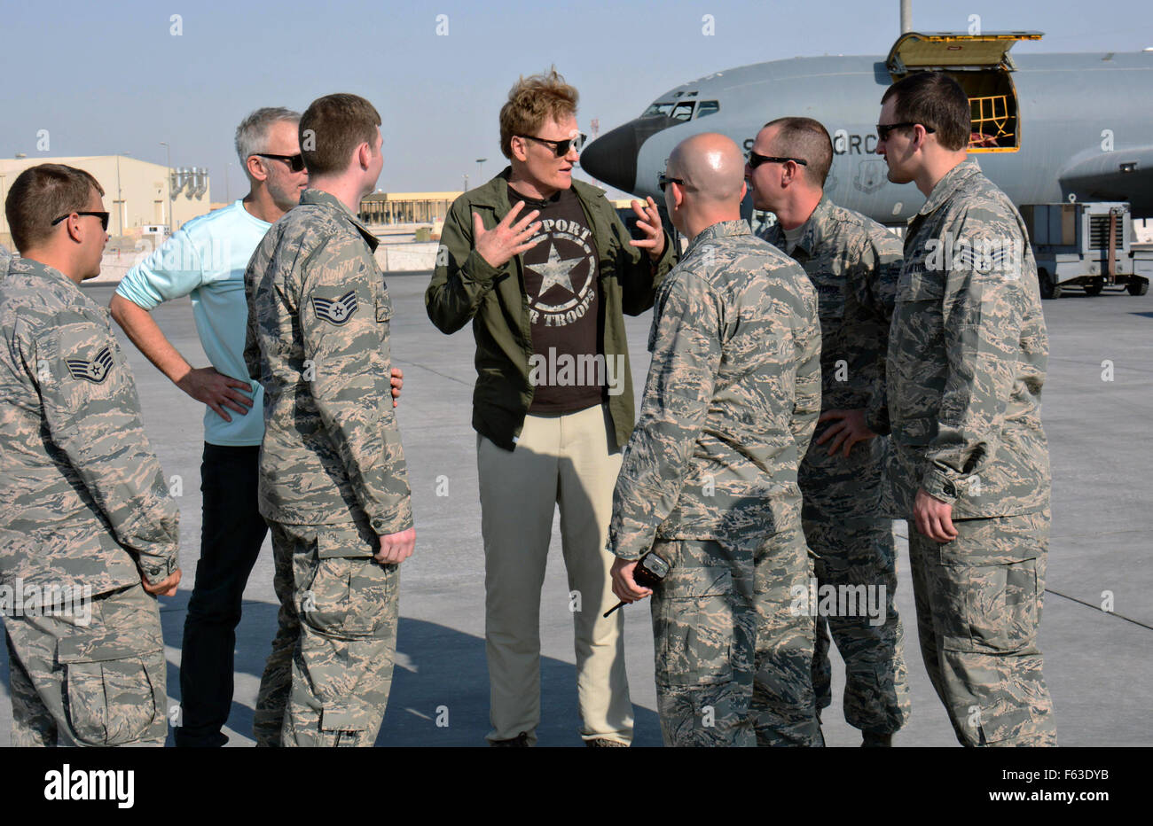 Late night talk show host and comedian Conan O'Brien speaks to U.S. airmen during a visit to the flight line - Stock Image