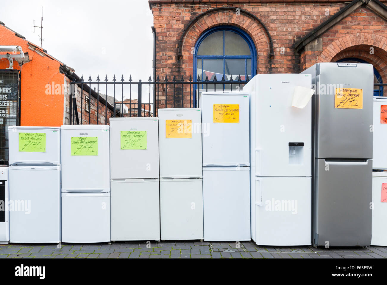 Shop selling second hand fridge freezers and other used white goods on a high street in a UK town centre, Netherfield, - Stock Image