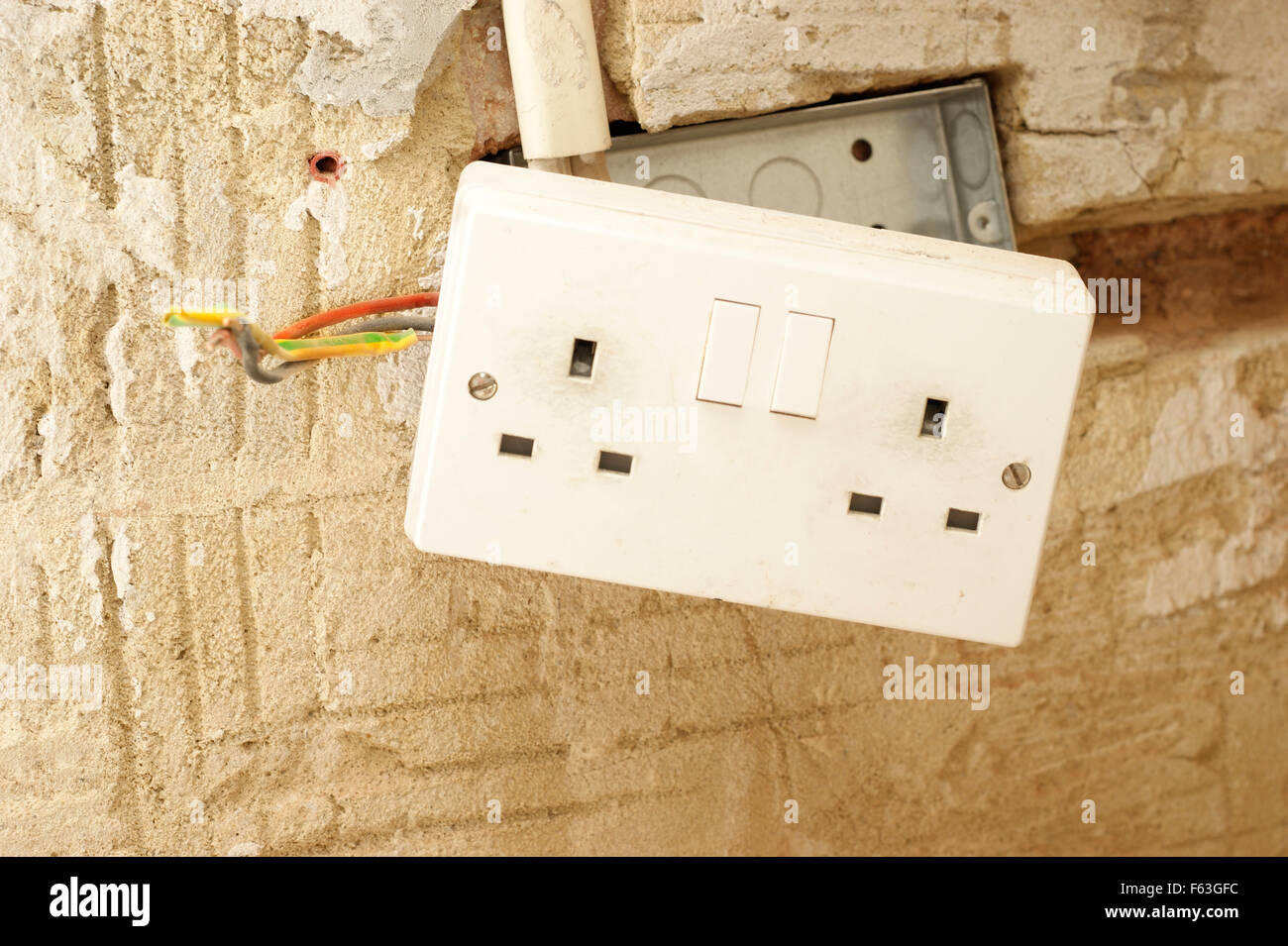 Plug Sockets Uk Stock Photos Images Alamy Socket Wiring Electric With Exposed In A Rented Social Housing Property House That Needs Attending