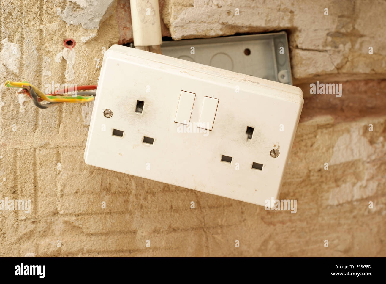 electric plug sockets with exposed wiring in a rented social housingelectric plug sockets with exposed wiring in a rented social housing property house that needs attending to