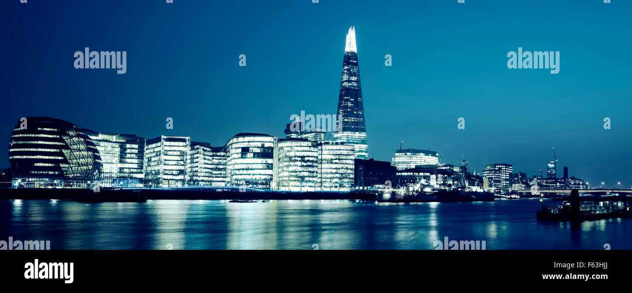 Panoramic view of new London city hall at night, special photographic processing. - Stock Image