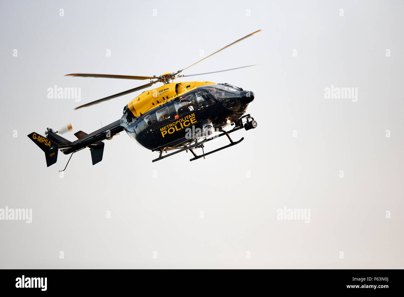 A Metropolitan Police helicopter flies over London to observe crowd movement during a major sports event in the - Stock Image