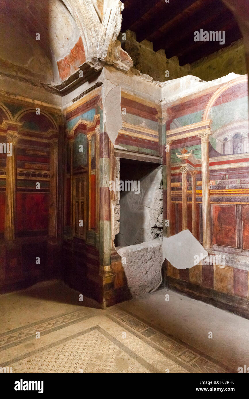 Fresco wall mural and decorative elements on a wall at Villa dei Misteri, Villa of the Mysteries, Pompeii, Italy - Stock Image