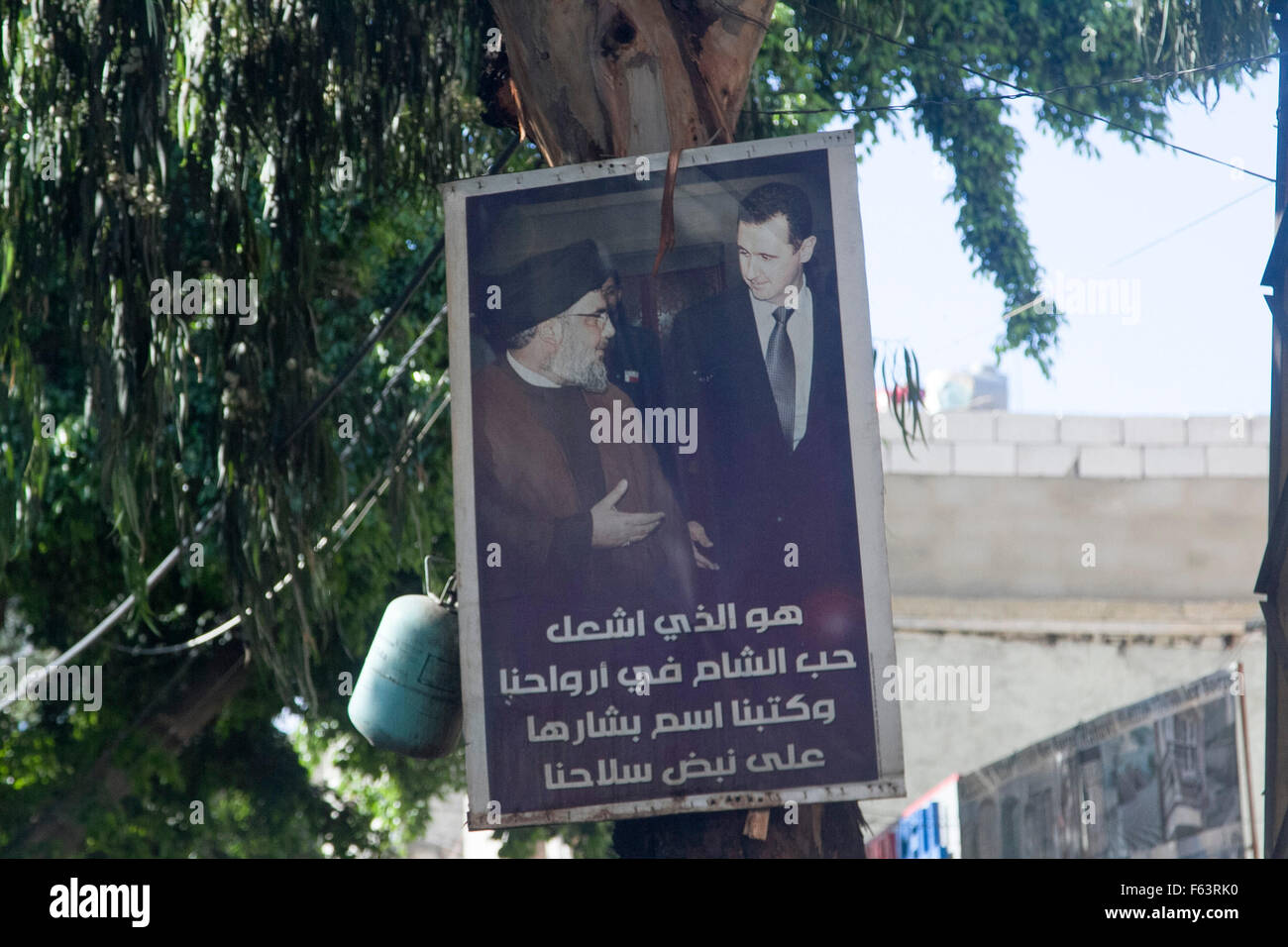 Beirut Lebanon, 11th November 2015. A poster showing President Assad of Syria (R) together with Hassan Nasrallah - Stock Image