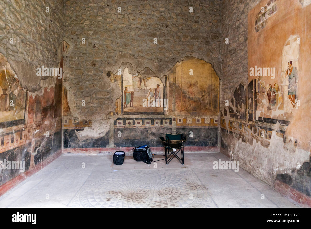 Fresco mural wall paintings at the Casa Degli Amorini Dorati, House of the Gilded Cupids, Pompeii are monitored and restored Stock Photo