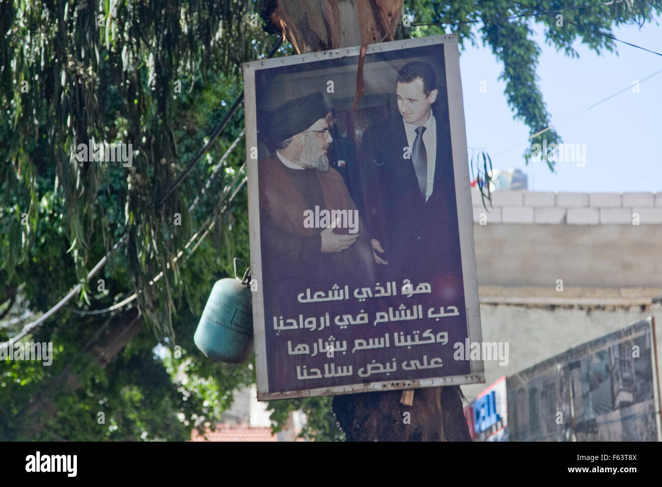 Beirut Lebanon, 11th November 2015. A poster showing President Assad of Syria (R) together with the Lebanese spiritual - Stock Image