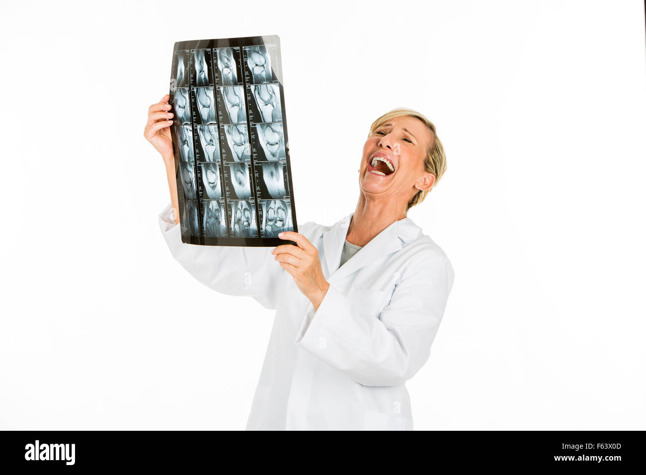 doctor woman looking at patient x-rays - Stock Image