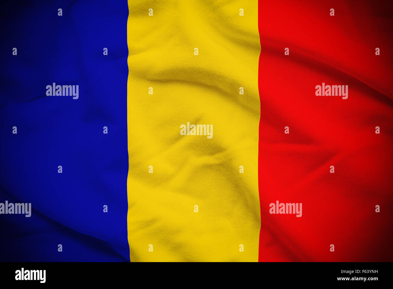 Wavy and rippled national flag of Chad background. Stock Photo
