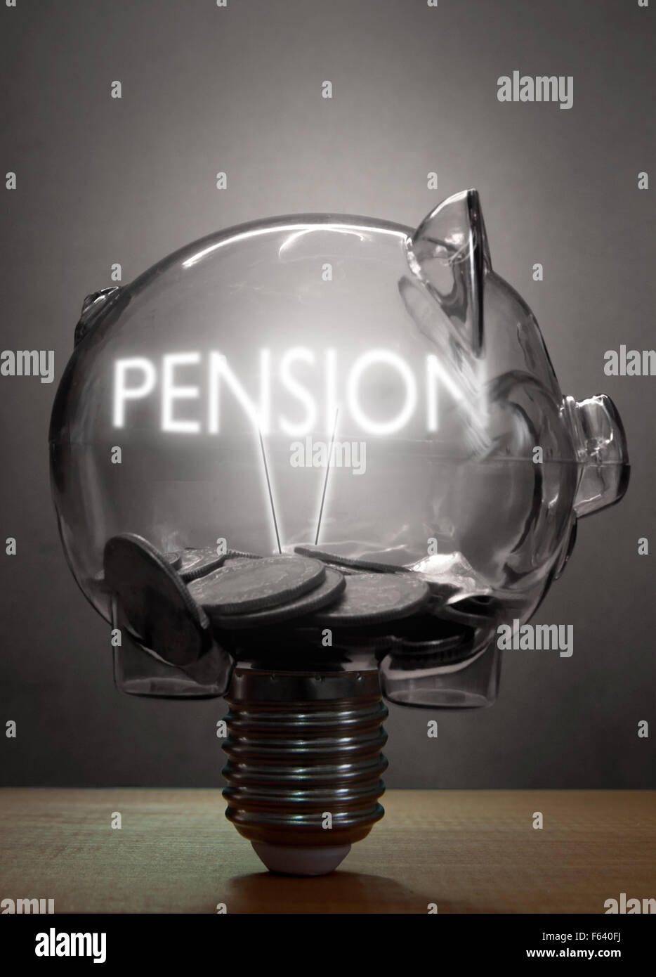 Piggybank light bulb with pension lit text inside and cash - Stock Image