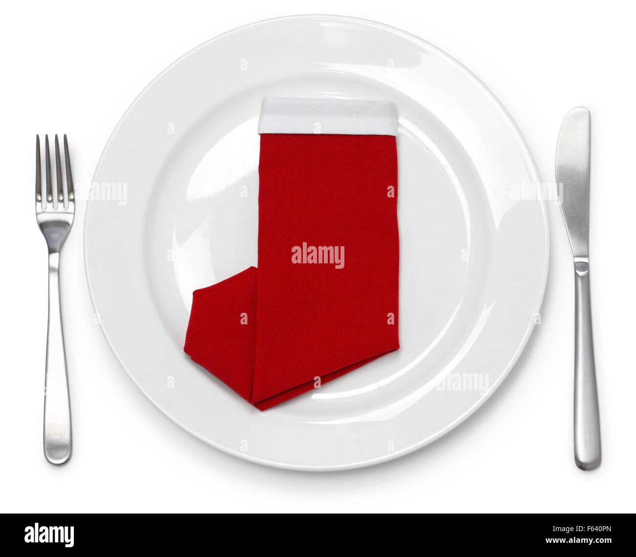 Christmas Dinner Table Setting Napkin Folded As A Santa Claus Boots Stock Photo Alamy