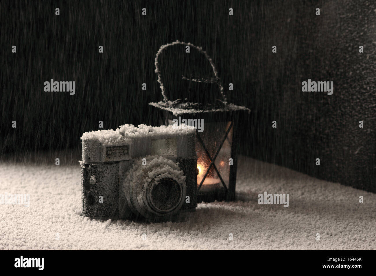 Old camera in the snowing - Stock Image