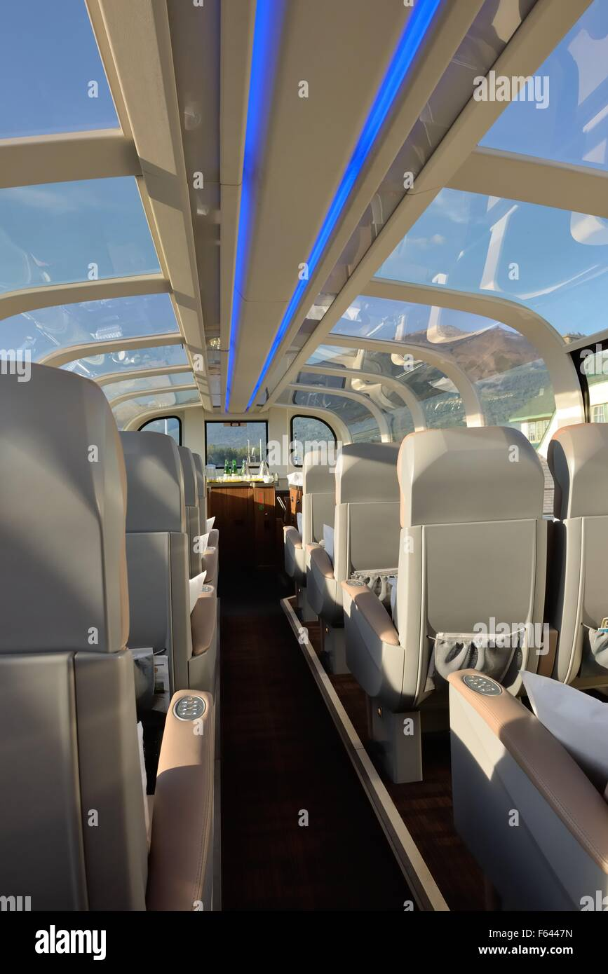Luxurious leather seats and glass roof of the Rocky Mountaineer passenger train in Canada - Stock Image