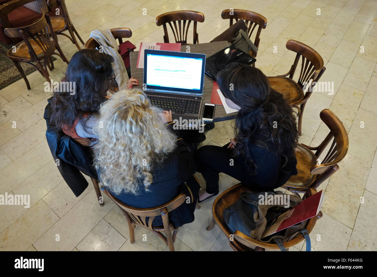 Israeli students using a laptop computer in a coffeehouse in Jerusalem Israel - Stock Image