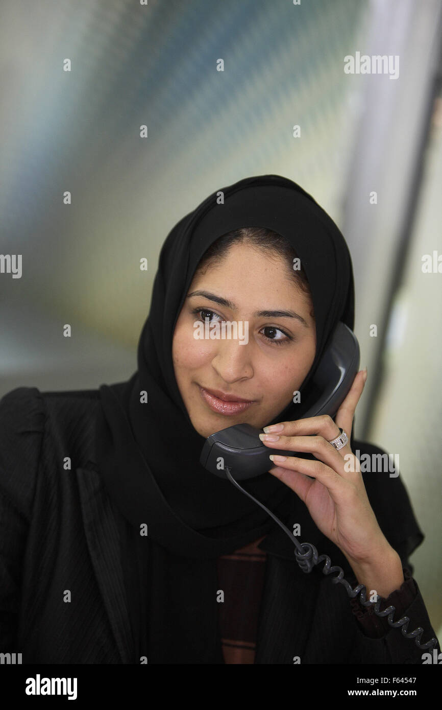 Arab Lady talks on phone - Stock Image