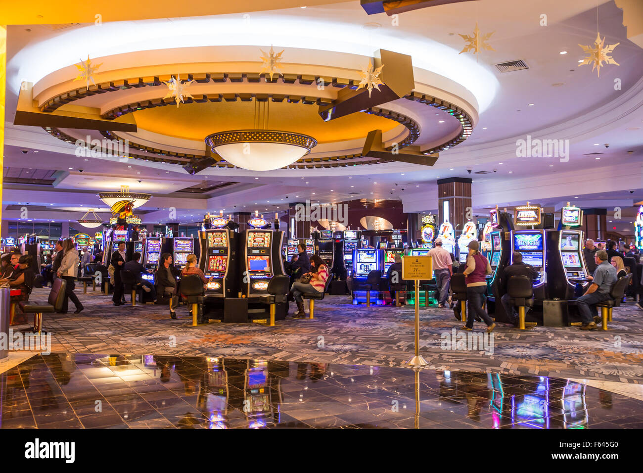 View of people gambling at slot machines at Foxwoods Casino. - Stock Image