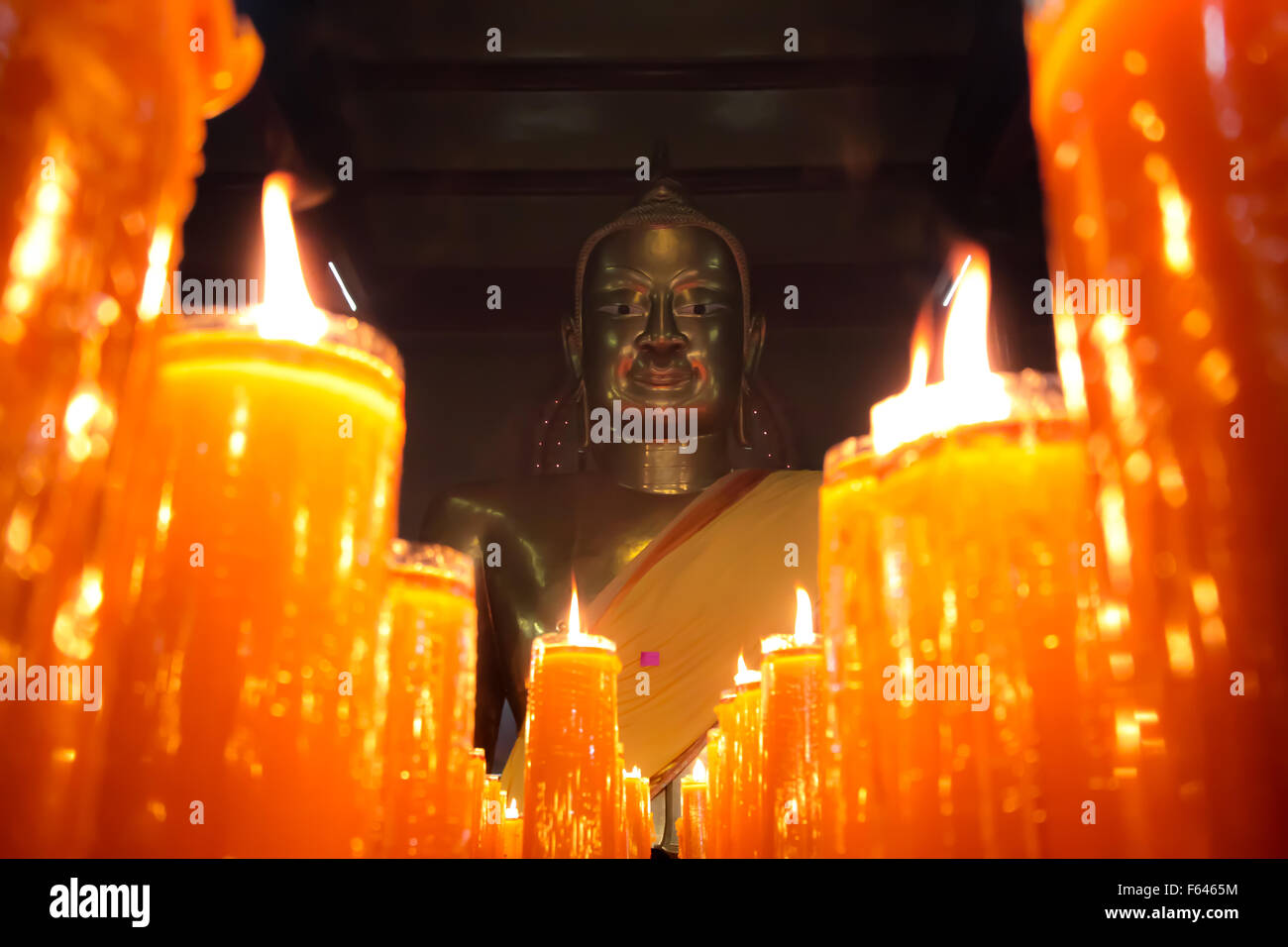 Buddha Statue with Candles - Chachoengsao, Thailand - Stock Image
