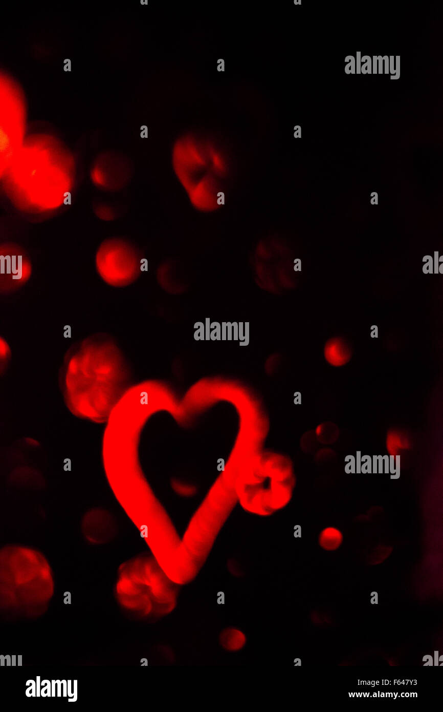 Red Heart With Cotton Clouds On Black Background Vertical Stock Photo Alamy