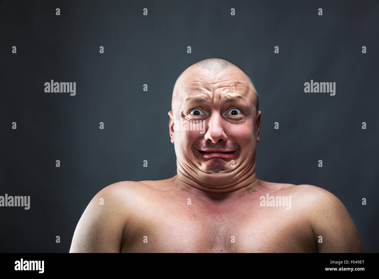 Portrait of bald man with scared face - Stock Image