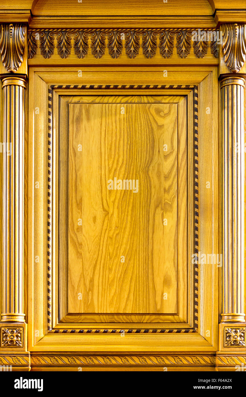 Wooden decorated facade of furniture closeup - Stock Image