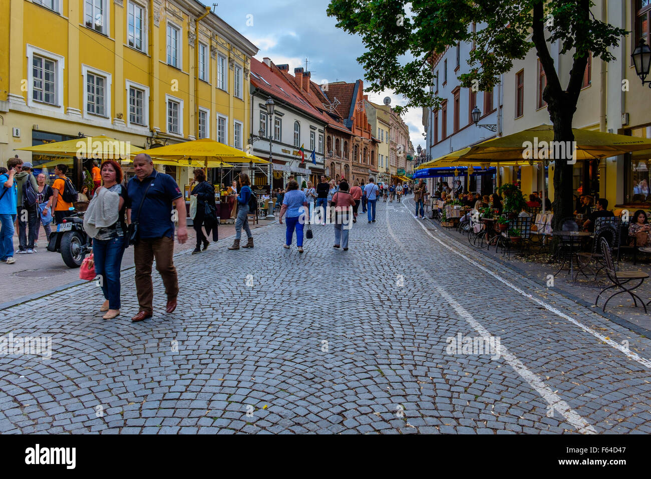 Street with sidewalk cafes in Vilnius, Lithuania - Stock Image