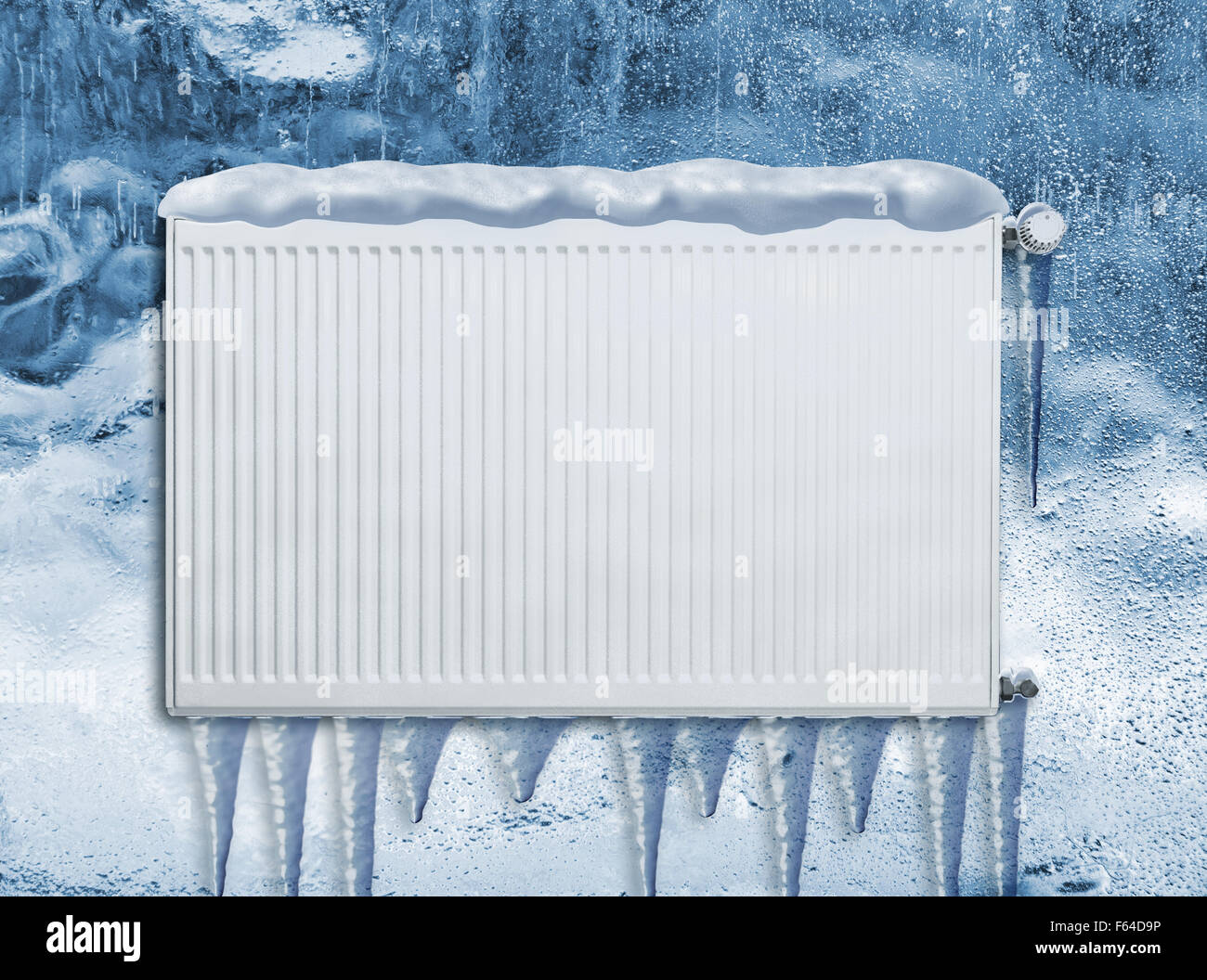 Frozen heating radiator outside in winter covered with snow - Stock Image