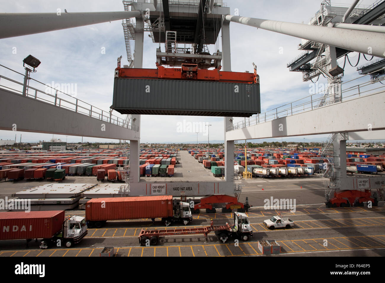 shipping container being loaded on ship - Stock Image