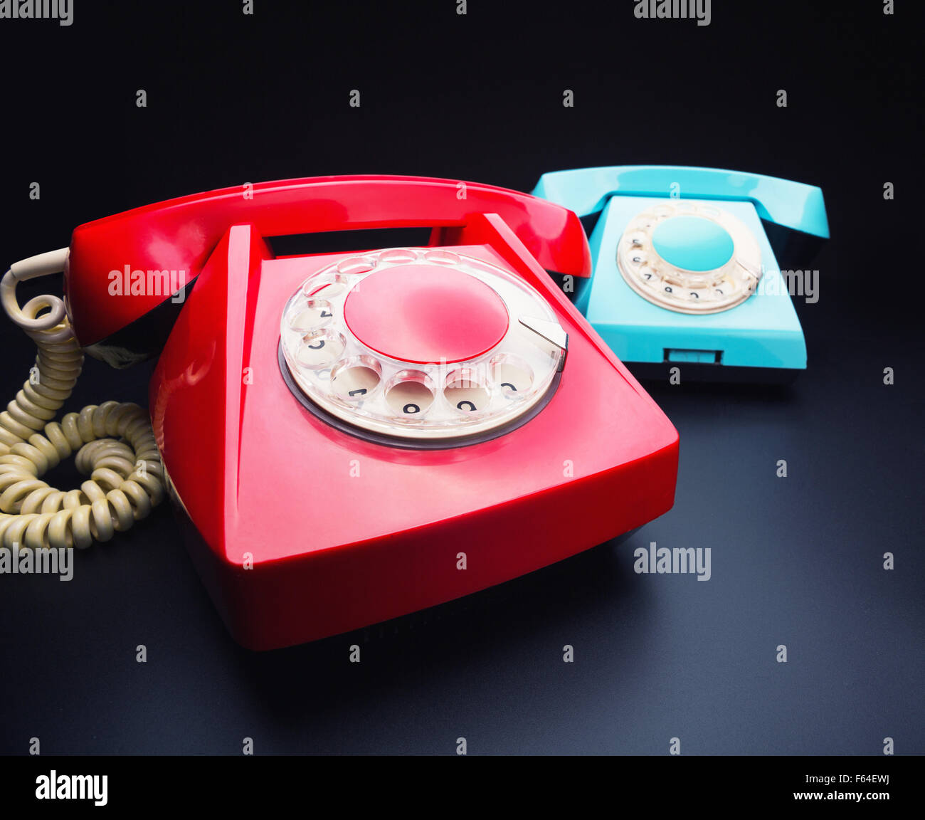 Vintage red and blue telephones - Stock Image