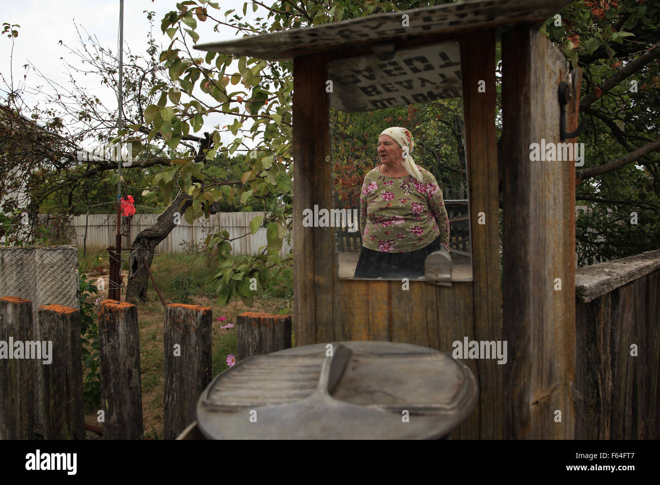 Maria Ilchenko, an illegal resident (Samosely), who returned after the Chernobyl disaster at her farm in the village - Stock Image