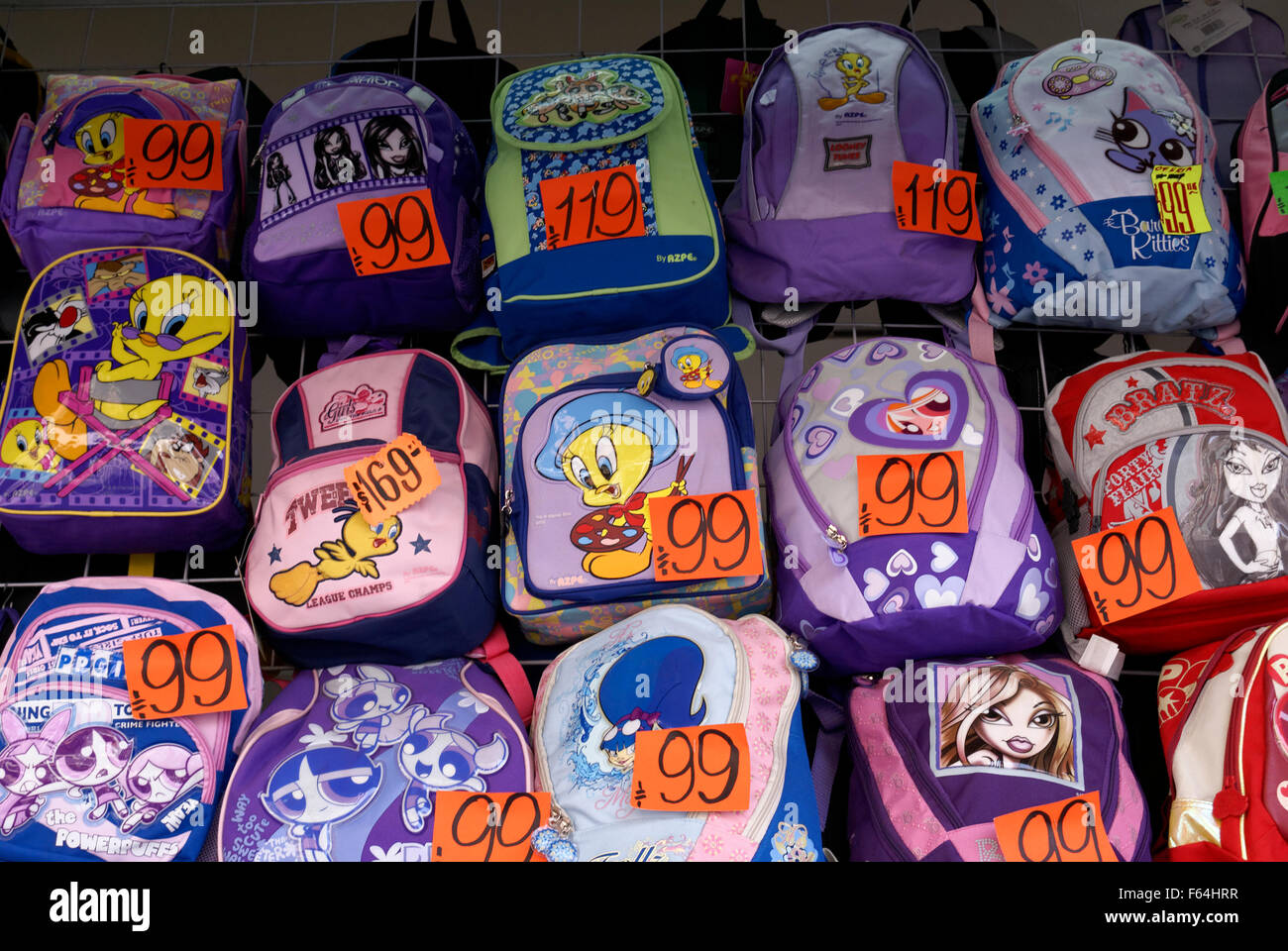 Colorful children's backpacks priced in Mexican pesos for sale in Mexico City - Stock Image