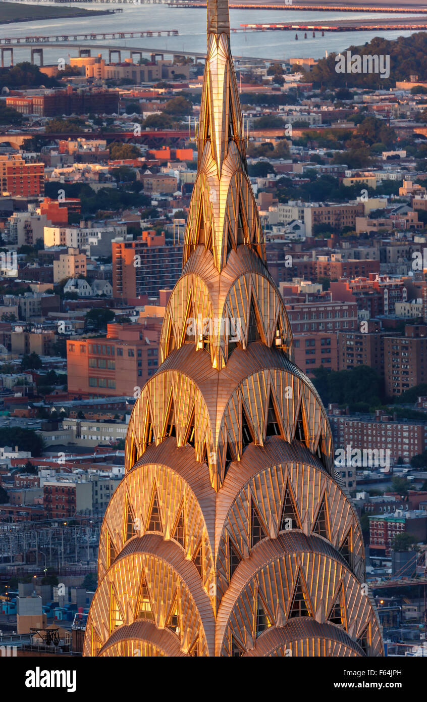 Detail of the Art Deco crown and spire of Chrysler Building in Midtown Manhattan at sunset. New York City aerial - Stock Image