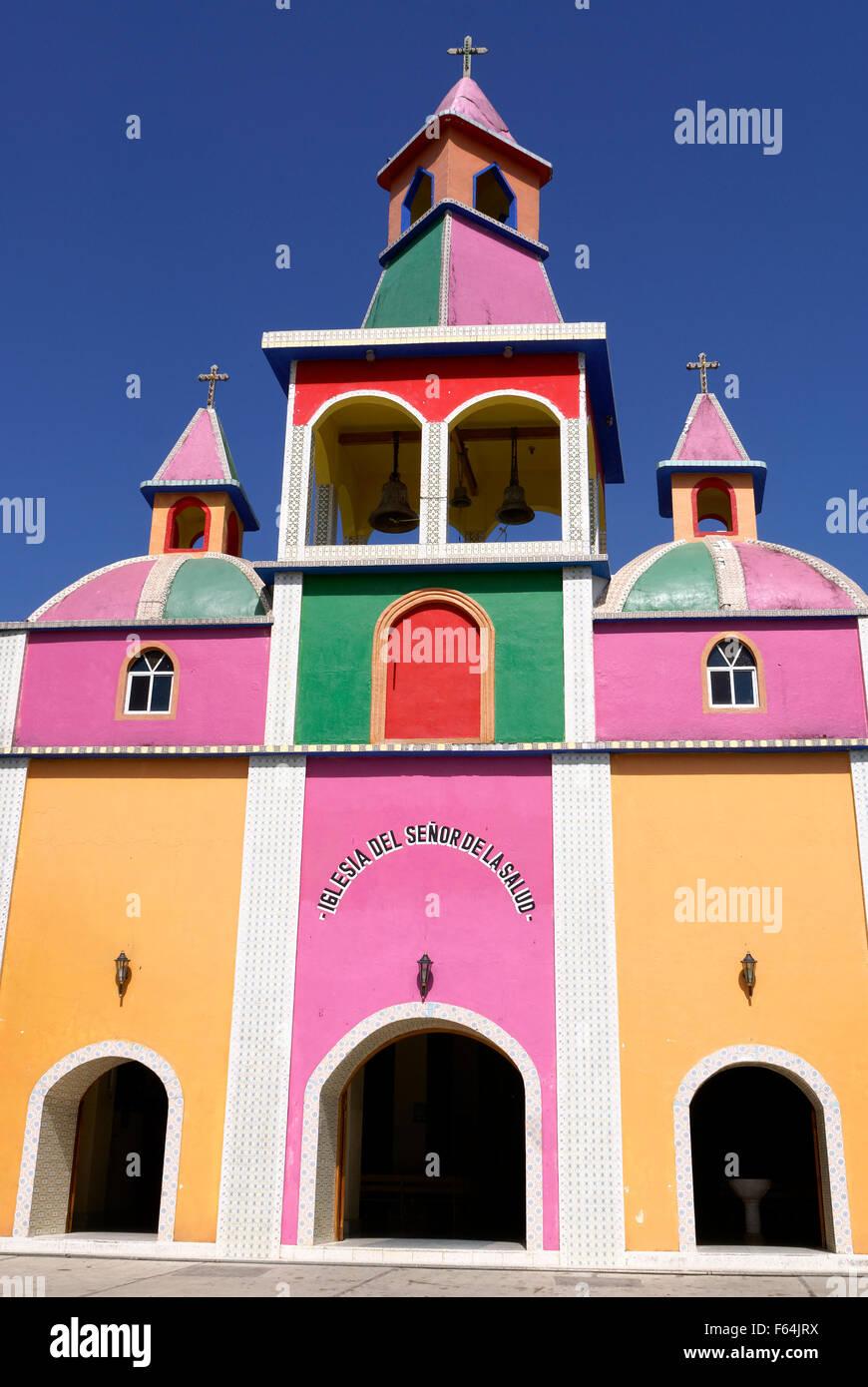 Brightly painted Mexican church at Herbolaria Beto Ramon, Aguacatitla, Axtla de Terrazas, San Luis Potosi state, - Stock Image