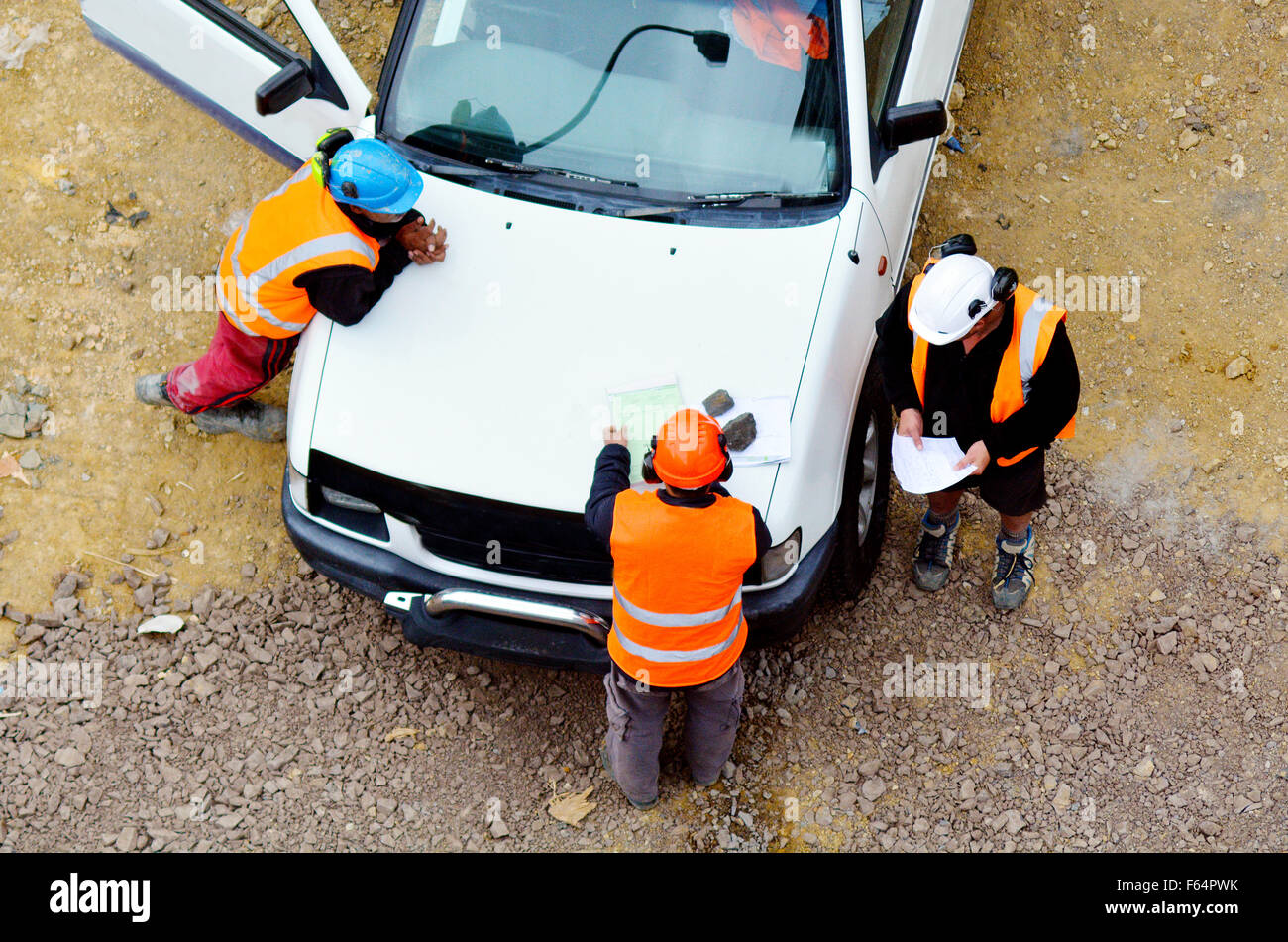 Aerial view of  workers follow instructions from construction manager - Stock Image