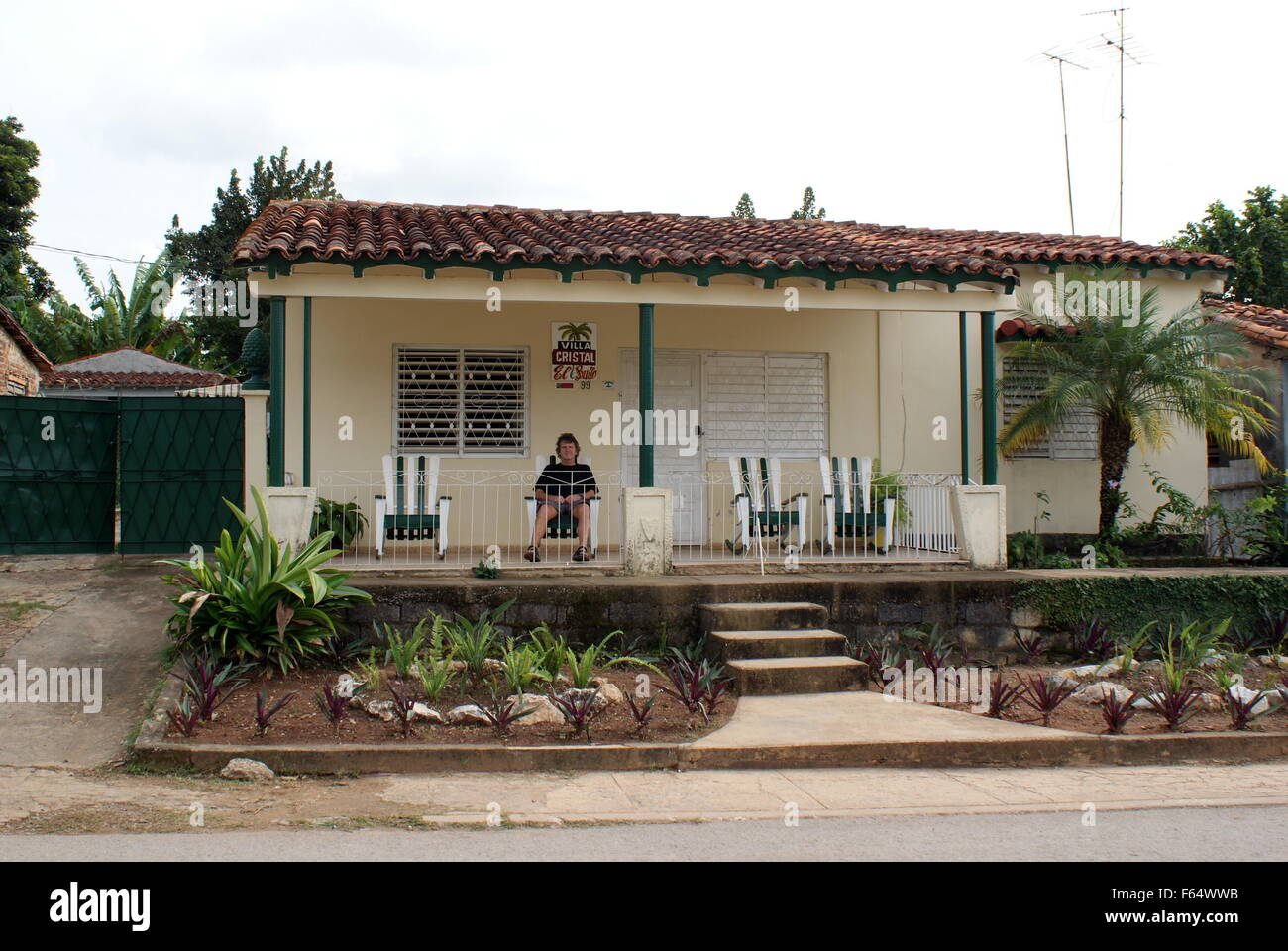 Sitting outside a casa particular (Cuban guest house), Vinales, Cuba - Stock Image
