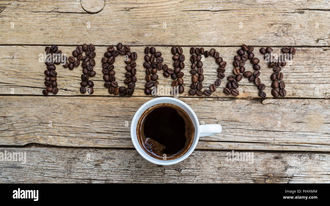 Cup of coffee on wooden background and Monday coffee beans Stock ... #mondayCoffee