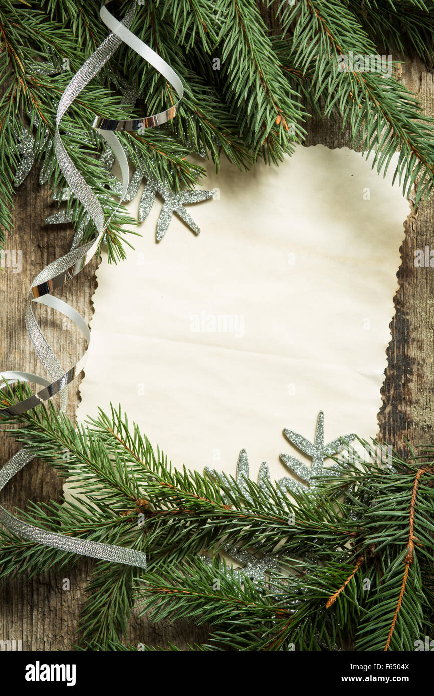 christmas tree branches with blank paper card and silver ribbon on wooden background top view image of christmas decoration - Blank Christmas Tree