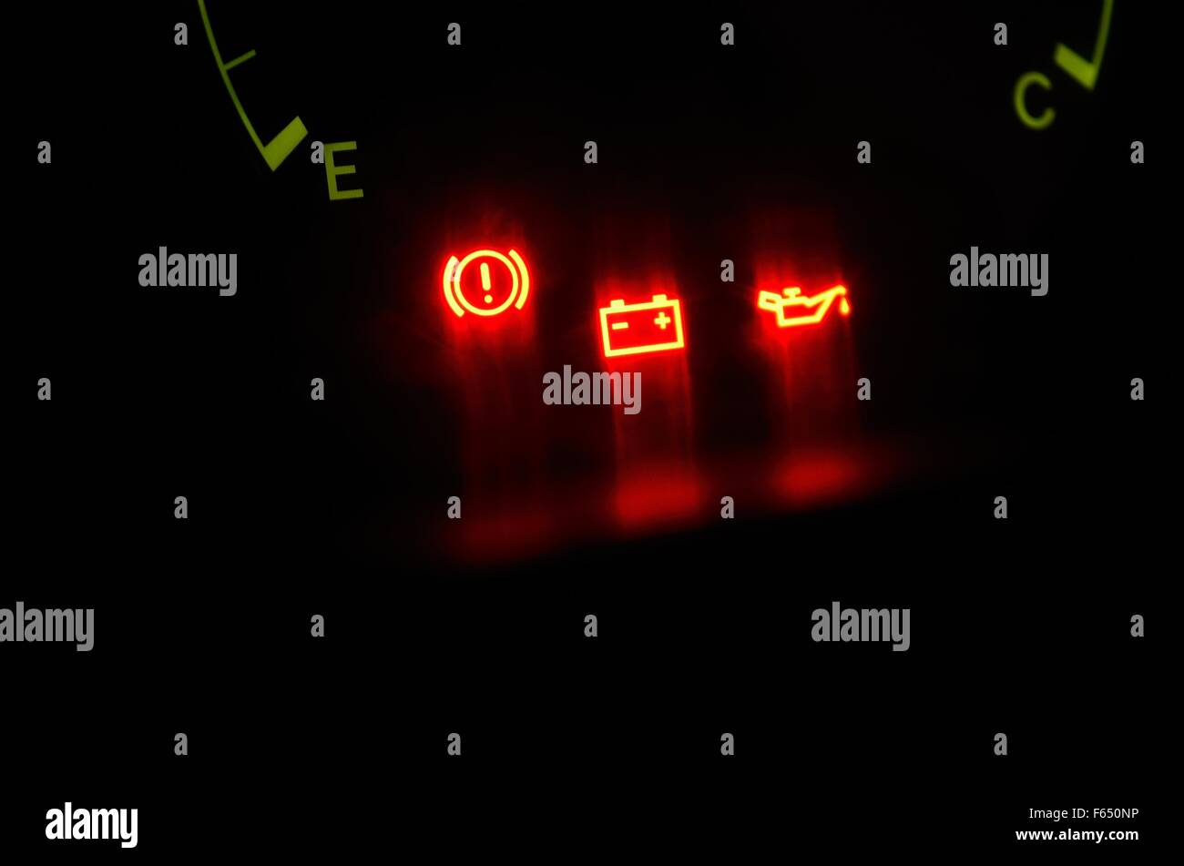 Oil, Emergency Brake And Battery Warning Lights On Car Dashboard