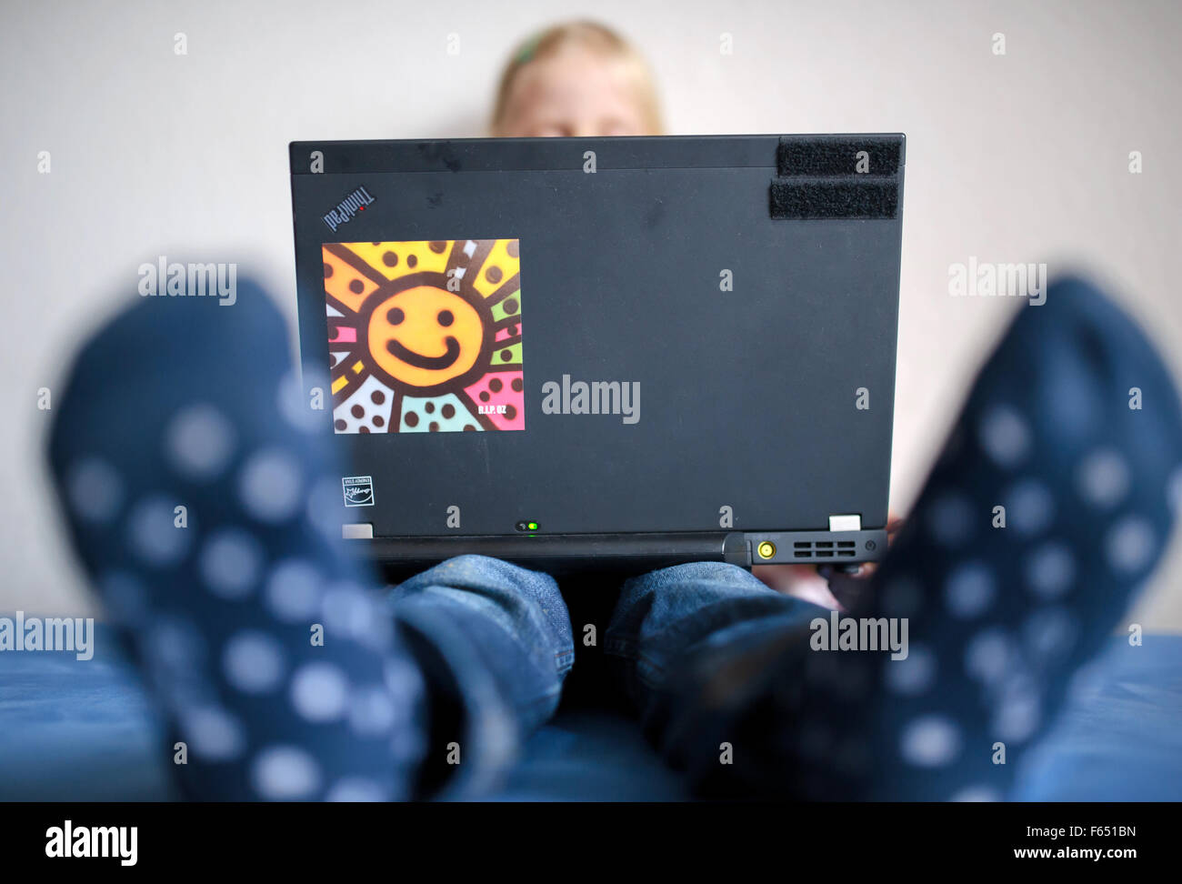 ILLUSTRATION - A child watches a cartoon on a laptop. The photo was taken on 06 January 2015 in Dresden (Saxony). Photo: Thomas Eisenhuth - model released - Stock Photo
