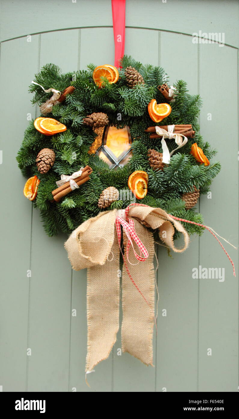 A Christmas Garland Or Wreath Featuring Cinnamon Sticks And Dried