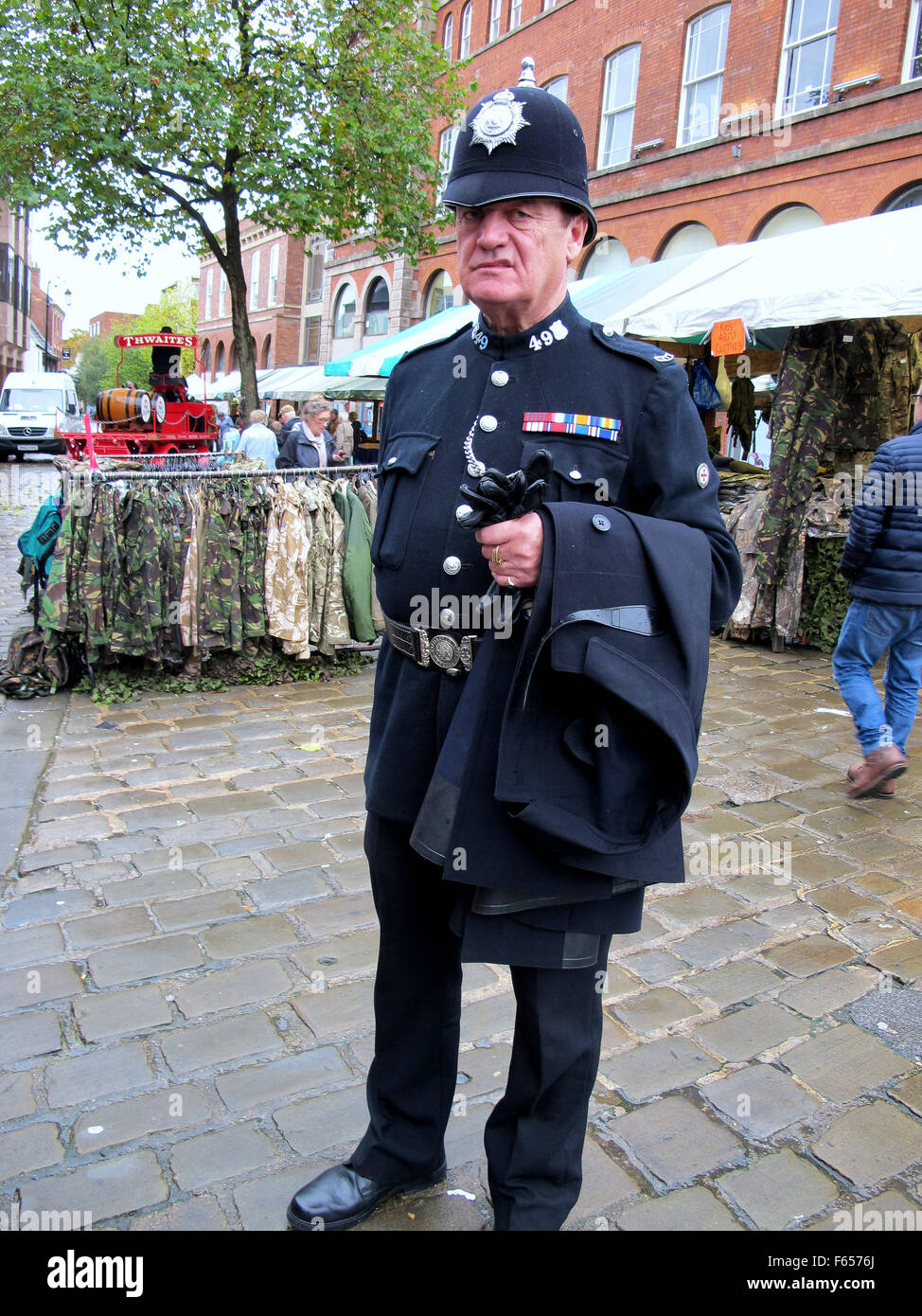 CHESTERFIELD, DERBYSHIRE, UK. OCTOBER 29, 2015.  A gentleman in a policeman's 1950s dress uniform of PC 49 at - Stock Image