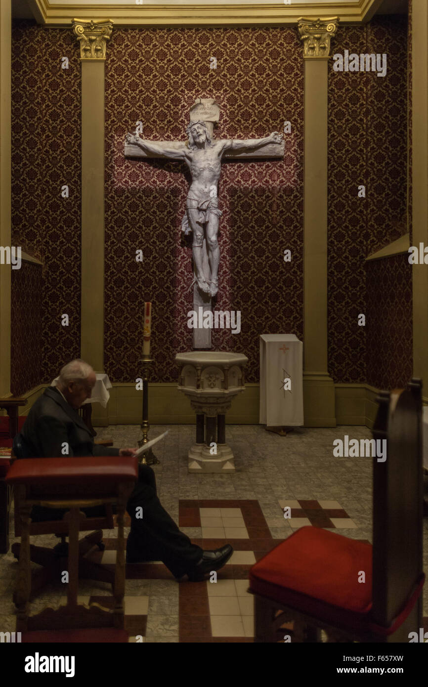 A Catholic priest waits for penitents in a Confessional Room in Our Lady Queen of the World Cathedral in Montreal - Stock Image