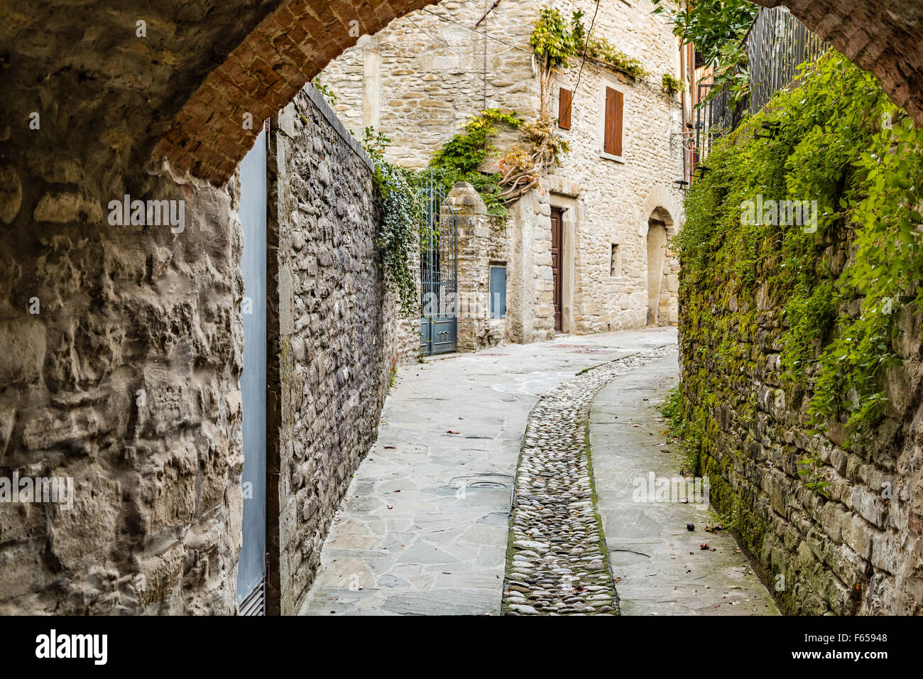 Alleys in medieval mountain village in Tuscany characterized by houses with walls of stones derived from the Renaissance Stock Photo