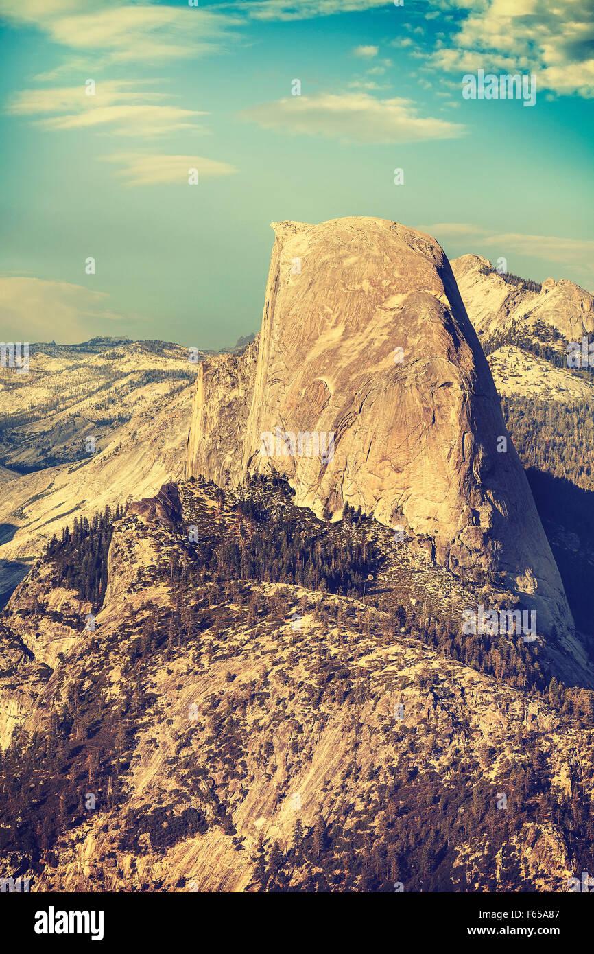Old film retro toned Half Dome rock formation, Yosemite National Park, USA. Stock Photo
