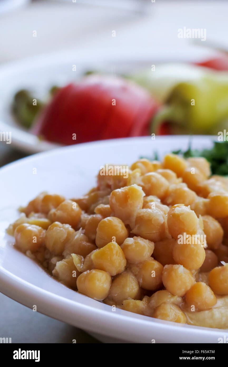 Hummus. A Levantine Arab dip or spread made from cooked, mashed chickpeas, blended with tahini, olive oil, lemon Stock Photo