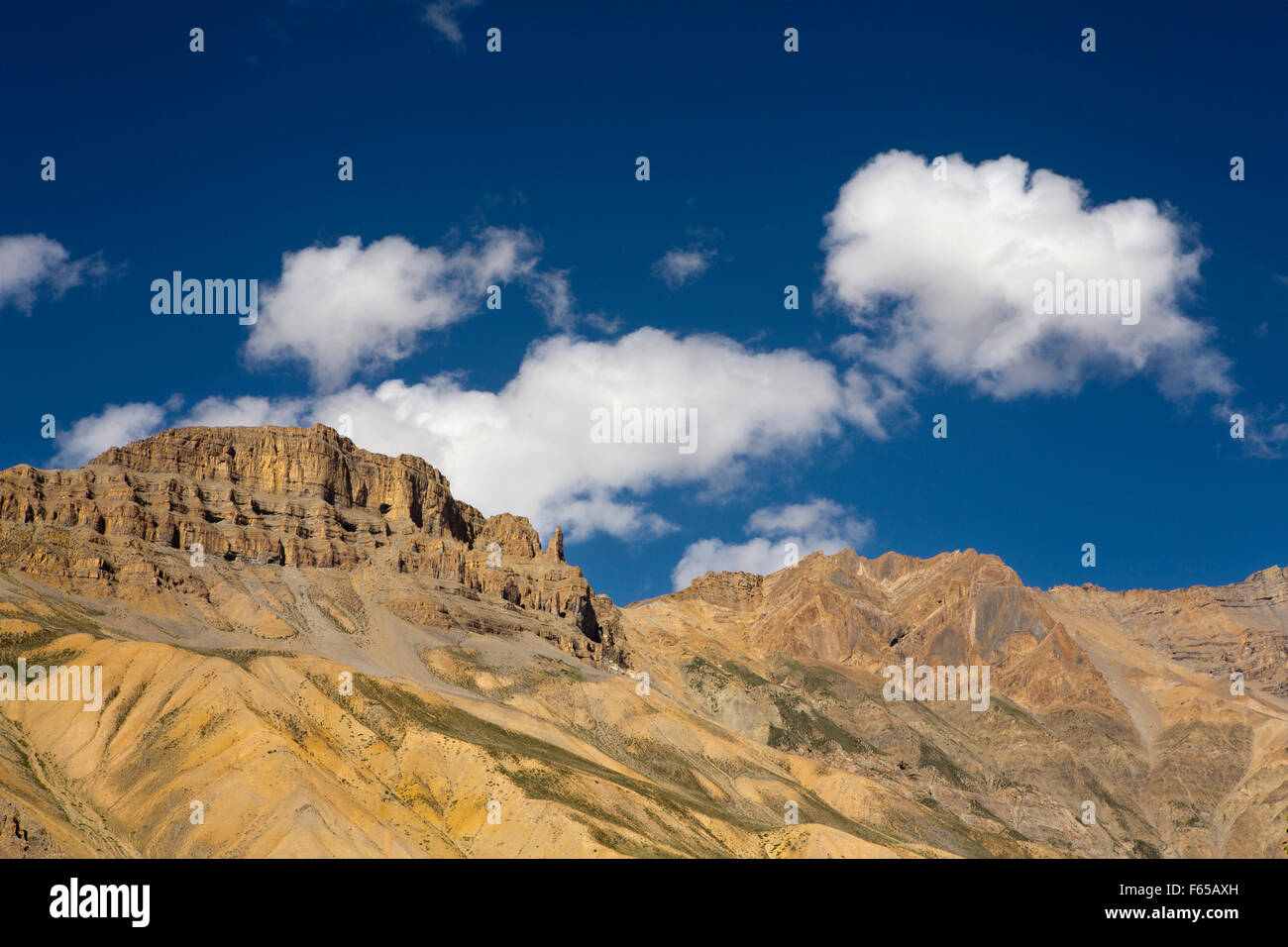 India, Himachal Pradesh, Spiti valley, Shego, rocky cold desert cliff against blue sky - Stock Image