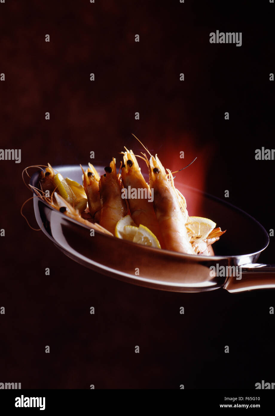 Flambéed shrimps Stock Photo